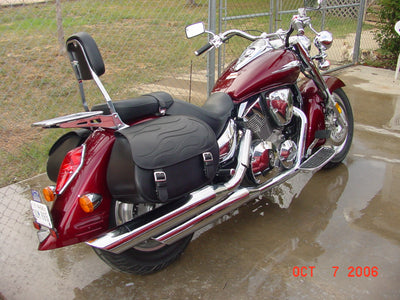 Honda VTX 1300R with black motorcycle saddlebags and a custom black flame leather flap