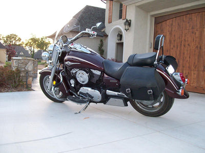 Kawasaki Vulcan 1600 with Black Leather Motorcycle Saddlebags and Embossed Inlay pattern. Parked in driveway.