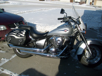 Kawasaki Vulcan parked in snowy driveway with new black leather motorcycle saddlebags installed by us saddlebag co.