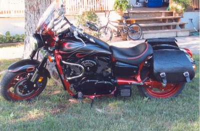 Kawasaki Mean Streak with black motorcycle saddlebags and a custom black flame leather flap