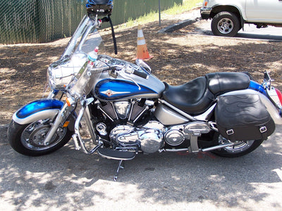 Kawasaki Vulcan with black motorcycle saddlebags and a custom black flame leather flap