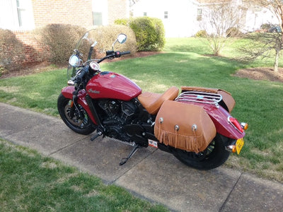 Tan Leather Saddlebags with Fringe on a Red Indian Scout Motorcycle side view