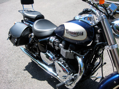 Triumph America with blue and white paint job customized with US Saddlebag's signature classic black leather motorcycle saddlebags