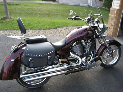 Studded Black Leather Motorcycle Saddlebags mounted to Victory Kingpin
