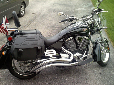 Victory Kingpin with black motorcycle saddlebags and a custom black flame leather flap