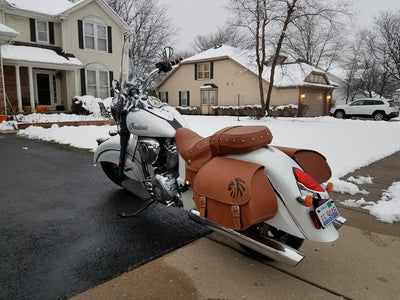 Desert Tan and Black Leather Saddlebags mounted on a White Indian Scout Motorcycle