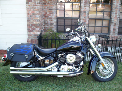 Yamaha Vstar with black motorcycle saddlebags customized with a blue flame leather inlay.