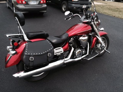 Studded Black Leather Motorcycle Saddlebags on a Red Yamaha V Star with passenger seat