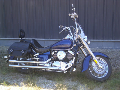 Yamaha Vstar with black motorcycle saddlebags and a custom black flame leather flap
