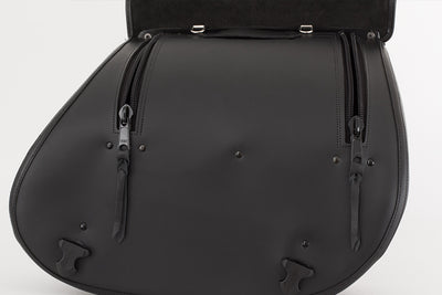 Interior view of our black leather saddlebags featuring high quality ykk zippers and d-rings to lock and protect your gear