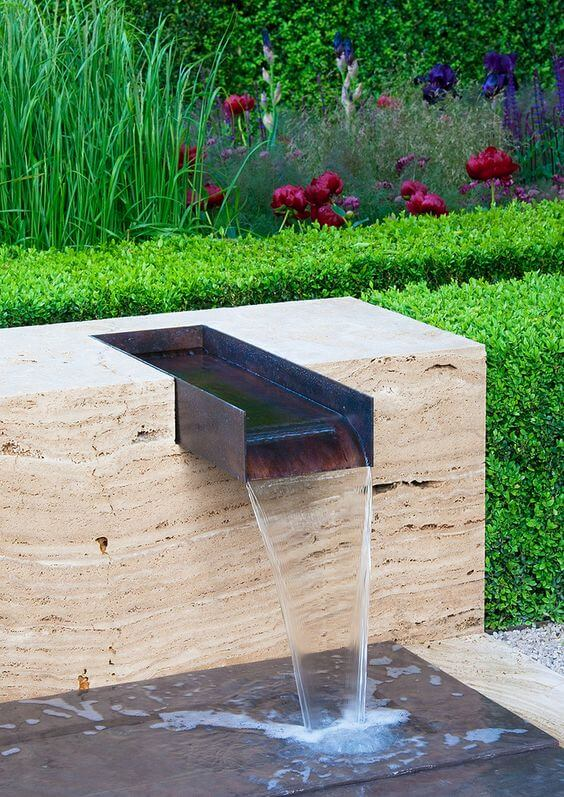 12 inch water spillway in water feature outdoors