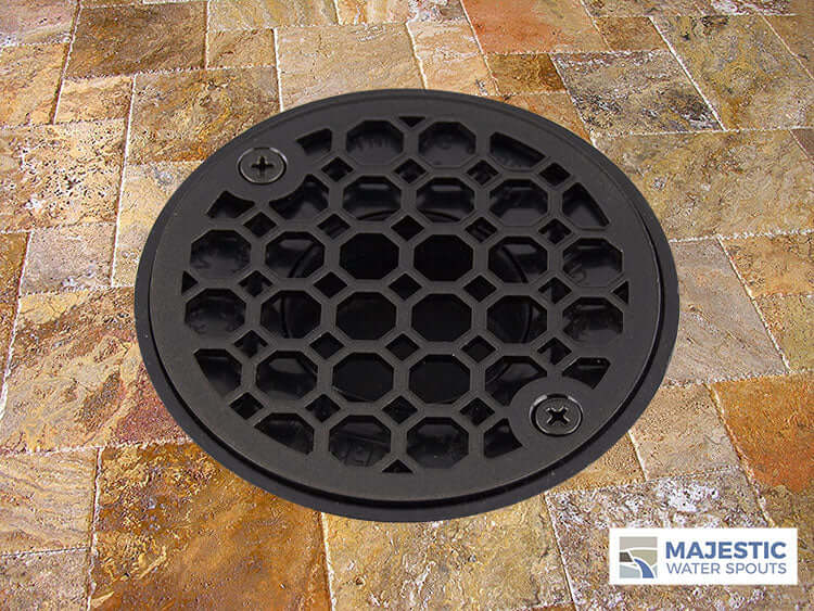 Bronze decorative shower drain cover installed in shower tiled