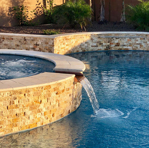 Copper spillway installed in spa to pool spillway