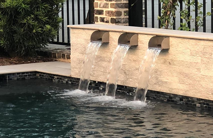 Stainless Steel Scuppers by Majestic Water Spouts in Pool with Limestone