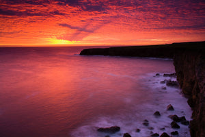 England, Tyne and Wear, South Shields. Sunrise over Frenchman's Bay near South Shields.