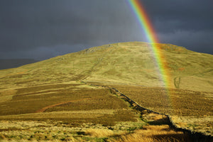 England, Northumberland, The Pennine Way. A rainbow above the Schil on the England / Scottish Border.