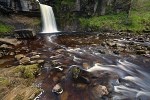 England, North Yorkshire, Ingleton. The fast flowing waters of the Thornton Force waterfall near Ingleton.