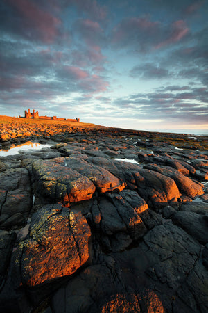 England, Northumberland, Dunstanburgh Castle. Dunstanburgh Castle at dawn, located along the Northumberland Heritage Coast.