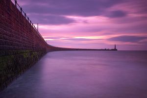 England, Tyne and Wear, Sunderland. The pink hues of a mid-summer sunrise at Roker Pier near the city of Sunderland.