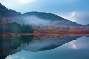 England, Cumbria, The Lake District. A misty dawn at Blea Tarn near Great Langdale.