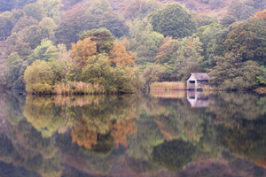 England, Cumbria, Lake District National Park. Early morning reflections at Rydal Water, on a still autumn day.