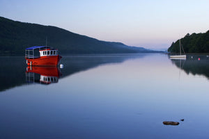 England, Cumbria, Lake District National Park. Dawn looking across the still waters of Coniston Water, within the Lake District National Park.