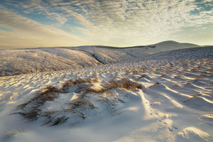 England, Northumberland, Harthope Valley. A winter scene of the snow covered Cheviot Hills looking from Snear Hill towards Hedgehope Hill, within the Northumberland National Park near Wooler.