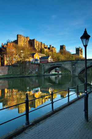 England, County Durham, Durham City. Bridge over the River Wear in the city of Durham, with Durham Castle, Cathedral and city reflected upon the still water face.