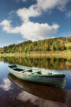 England, Cumbria, Lake District National Park. Fishing boat moored on Watendlath Tarn, which is located high between the Borrowdale and Thirlmere valleyy.
