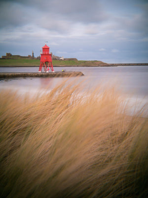 England, Tyne & Wear, South Shields. Little Haven Beach, looking towards the South Groyne Lighthouse.
