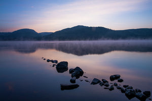 England, Cumbria, Lake District National Park. Dawn at Low Wray, looking across the still waters of Windermere, the largest lake to be found in England.