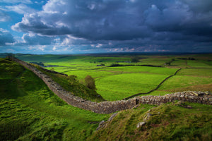 England, Northumberland, Northumberland National Park. A well preserved stretch of Hadrian's Wall passing along Caw Gap.