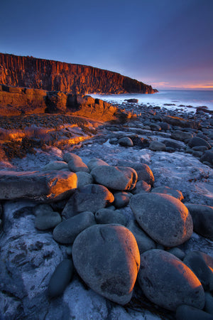 England, Northumberland, Cullernose Point. Dawn light illuminates the rocky shoreline of Cullernose Point, near the village of Craster on the Northumberland Heritage Coast.