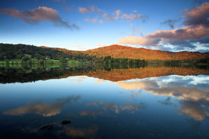 England, Cumbria, Lake District National Park. Early morning reflections at Lake Grasmere, on a still autumn day.