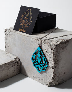 Turquoise Diamond vulva - wooden necklace