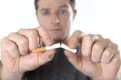 Man breaking cigarette quit smoking