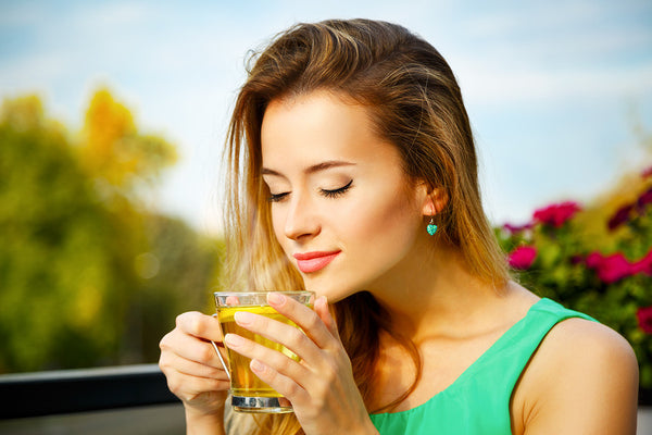 Woman Drinking Tea Secret To Quitting Smoking