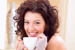 Woman sipping herbal quit smoking tea