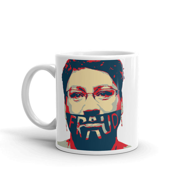 Her Mug on a Mug: The face of Fraud 11oz ( image facing the mugs in the office)