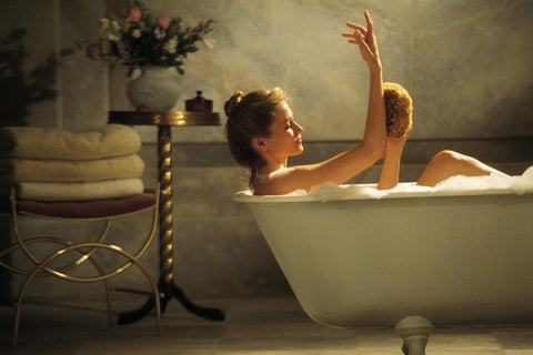 Woman taking an epsom salt bath for sore muscles