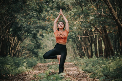 yoga in forest woman