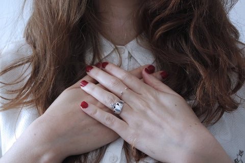 woman grateful holding hands to chest and heart