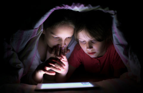 insomnia kids on their tablet instead of sleeping