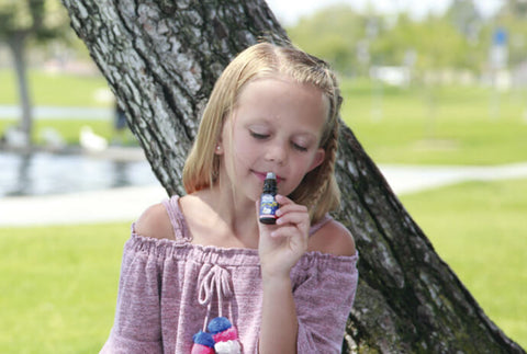 Young girl enjoying essential oils
