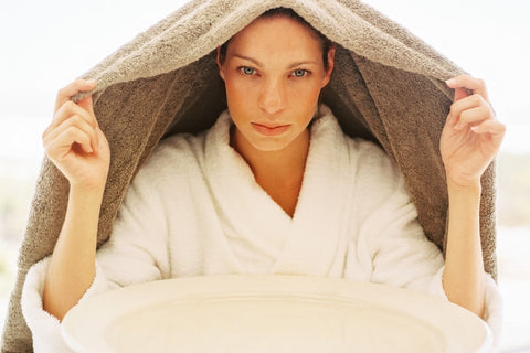 Woman with towel over head