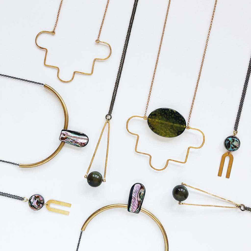 Geometric jewelry from Third & Co. Studio for Nestology Shop in Grand Rapids Michigan, brass geometric jewelry with abalone, agate, and labradorite