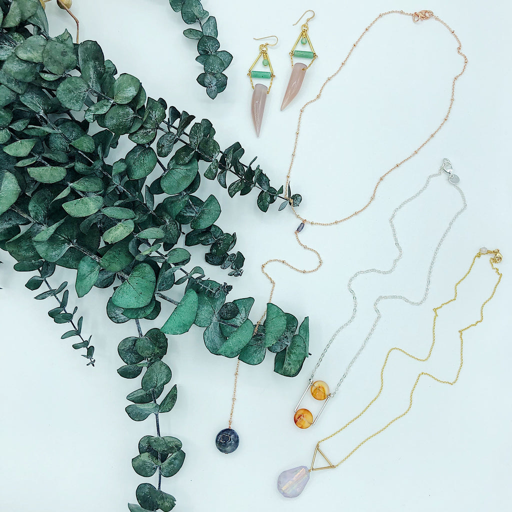 Third and Co Studio handmade semiprecious stone jewelry; Andromeda Necklace with gold plated satellite chain and blue Iolite lariat, Ursa Necklace in sterling silver and red orange carnelian, Prism Necklace with rainbow electroplated faceted quartz and vermeil chain with eucalyptus
