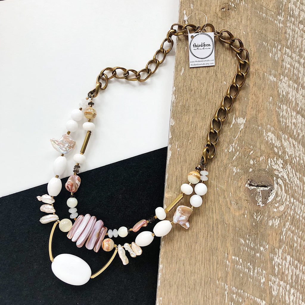 Semiprecious stone statement necklace from Third & Co. Studio handmade in Michigan with white Jade, peach Fresh Water Pearl, pink Baroque Pearl, pink Mother of Pearl, brass accents and vintage brass chunky chain with toggle closure