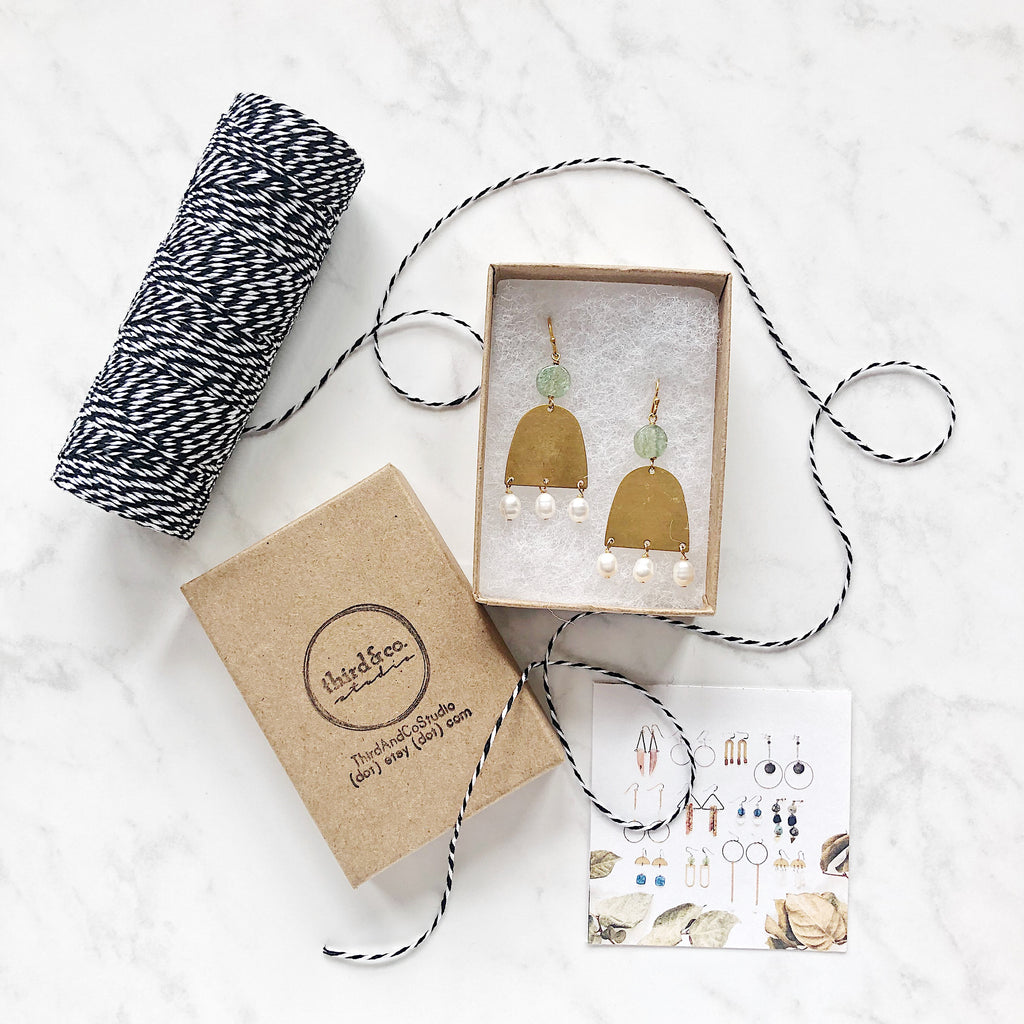 Custom packaging from Third & Co. Studio Etsy shop with recycled Kraft boxes with one of a kind earrings in fresh water pearl, brass and aquamarine