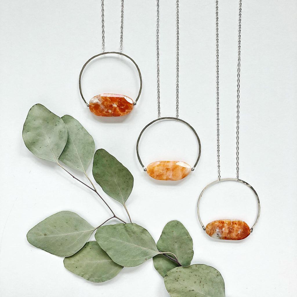 Third & Co. Studio of Grand Rapids, Michigan handmade semiprecious stone jewelry in small batch collections, available in wholesale and retail markets, spotted orange and cream chalcedony slab geometric necklace with silver